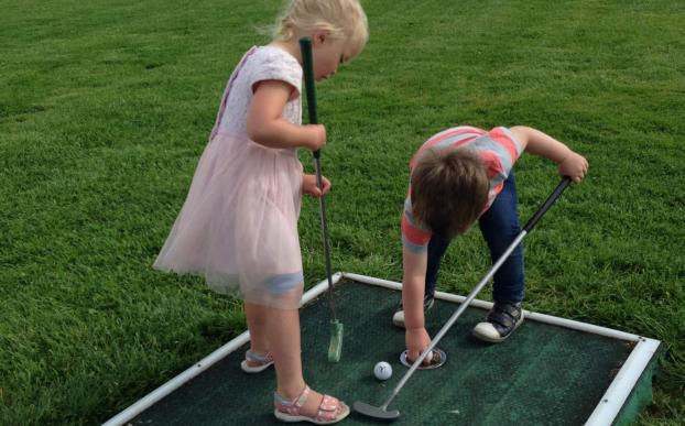 Kids playing crazy golf