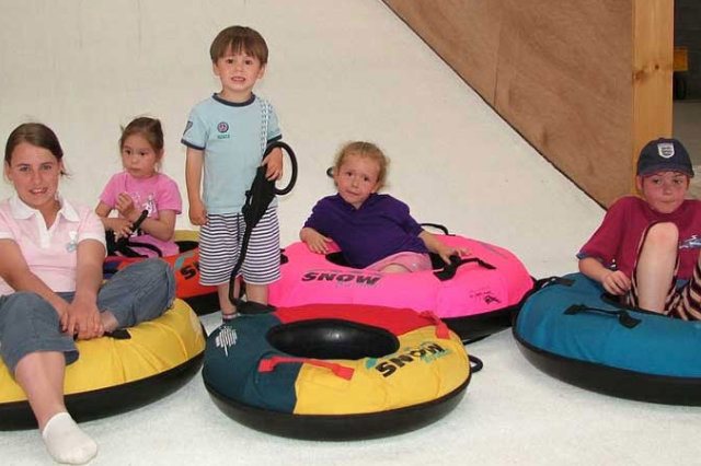 children resting on inflatable rings